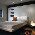 Patogi ir maloniai jauki lova, už kurios nuostabi siena
