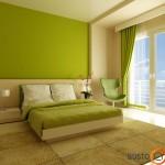 Gaivus laimo žalios miegamojo interjeras, kuriame gražiai įsilieja paprasta dvigulė lova bei žalias fotelis