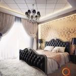 Žėrinti auksinė siena ir juoda prabangių apmušalų lova