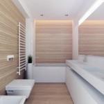 """Medis """"sušildo"""" minimalistinio stiliaus vonios kambario interjerą"""